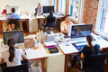 Wide Angle View Of Busy Design Office With Workers At Desks - PhotoDune Item for Sale
