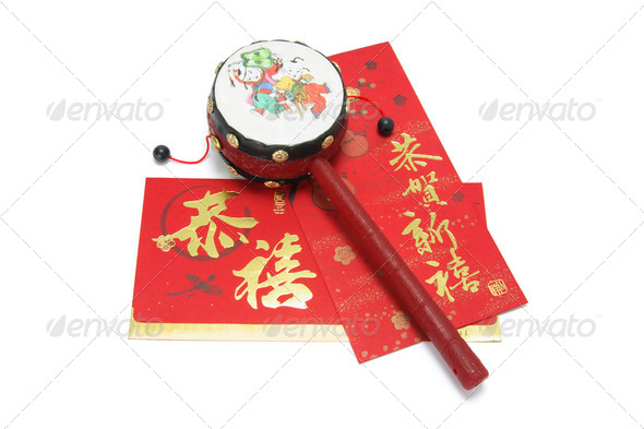 Chinese Tambourine and Red Packets - Stock Photo - Images