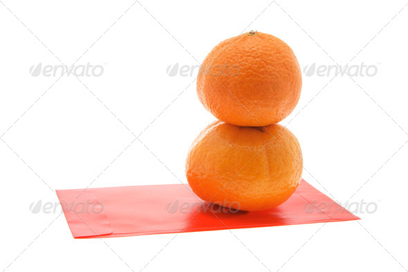 Mandarins and Red Packet - Stock Photo - Images