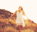 Happy Young Woman Outdoors at Susnet. Fashion Lifestyle. - PhotoDune Item for Sale