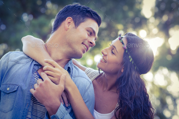 Cute couple in the park on a sunny day - Stock Photo - Images