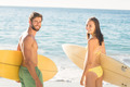 happy couple surfing at the beach - PhotoDune Item for Sale