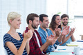 Young business people clapping hands in meeting at the office - PhotoDune Item for Sale