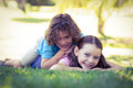 Portrait of two happy young kids playing at the park
