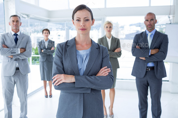 Businesswoman colleagues arm crossed in the office - Stock Photo - Images