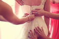 Hands helping the bride with the wedding dress - PhotoDune Item for Sale