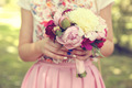 Hands of a woman holding beautiful peonies bouquet - PhotoDune Item for Sale