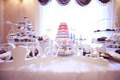 Mix of delicious cakes on table