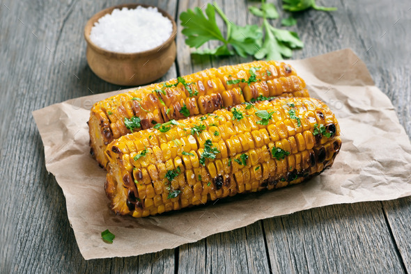 Grilled corn cobs on rustic table - Stock Photo - Images
