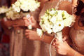 Bridesmaid holding lishianthus bouquet - PhotoDune Item for Sale