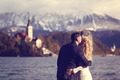 Bride and groom embracing near Bled lake