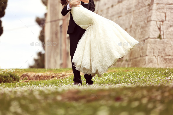 Bride and groom embracing - Stock Photo - Images