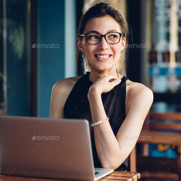 Attractive business woman working at his laptop - Stock Photo - Images