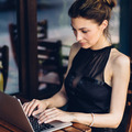 Attractive business woman working at his laptop - PhotoDune Item for Sale