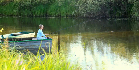 Little boy fishing from boat on river by androleksiienko for Little boy fishing
