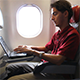 Man Working on Laptop on Airplane 1 - VideoHive Item for Sale
