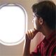 Man Looking Through the Airplane Window - VideoHive Item for Sale