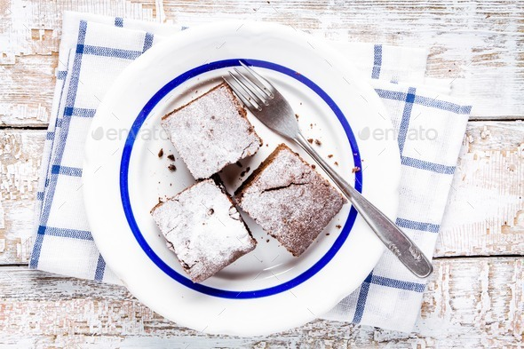 Three pieces of homemade chocolate brownie dessert on a plate - Stock Photo - Images