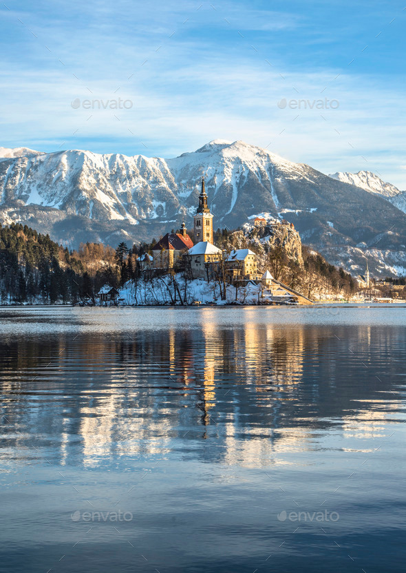 Bled on a beautiful winter morning. Sunrise over the church on the island - Stock Photo - Images