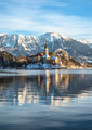 Bled on a beautiful winter morning. Sunrise over the church on the island - PhotoDune Item for Sale