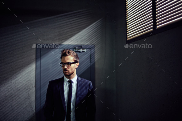 Businessman indoors - Stock Photo - Images