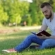 Young Man Sitting In The Park With His Diary - VideoHive Item for Sale