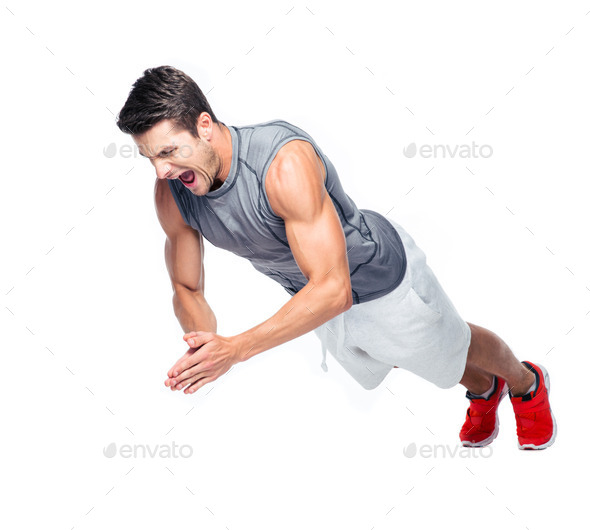 Fitness man doing exercises on the floor - Stock Photo - Images