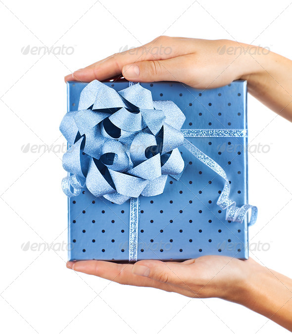 Female hands holding blue gift box - Stock Photo - Images