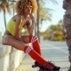 Adorable Roller Skate Girl Sitting At Beach - VideoHive Item for Sale