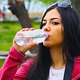 Photographer Girl Drinking Water In Park - VideoHive Item for Sale