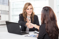 businesswoman shaking hand after a long negotiation - PhotoDune Item for Sale