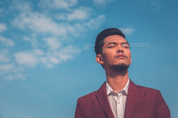 Handsome Asian model posing in the city streets - Stock Photo - Images