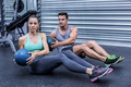 Portrait of muscular couple doing abdominal ball exercise - PhotoDune Item for Sale