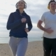 Couple Jogging On The Beach - VideoHive Item for Sale