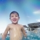 Boy Having Fun In The Pool On Resort - VideoHive Item for Sale