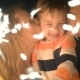 Family Of Three Holding Sparklers And Kissing  - VideoHive Item for Sale