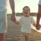 Happy Boy Walking With Grandparents Along The Pier - VideoHive Item for Sale