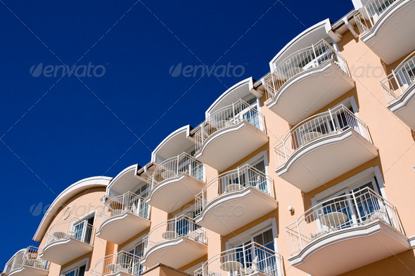 Orange facade with blue sky - Stock Photo - Images