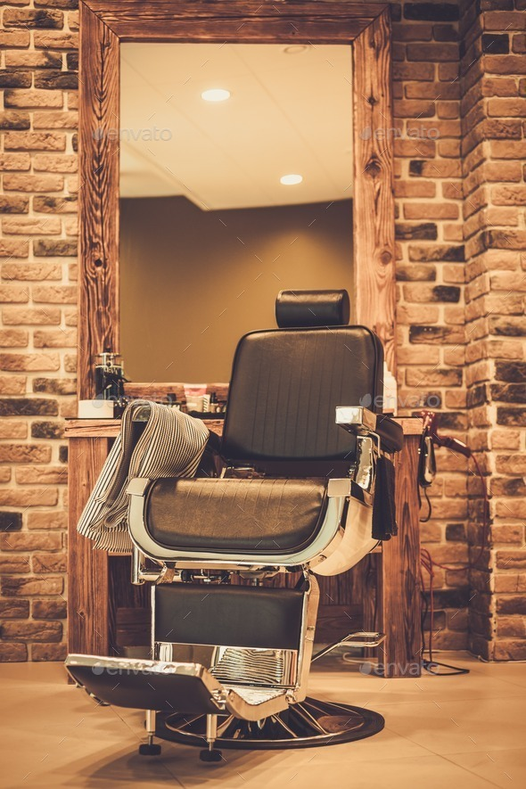 Client's chair in barber shop - Stock Photo - Images