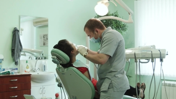 The Dentist Treats Tooth
