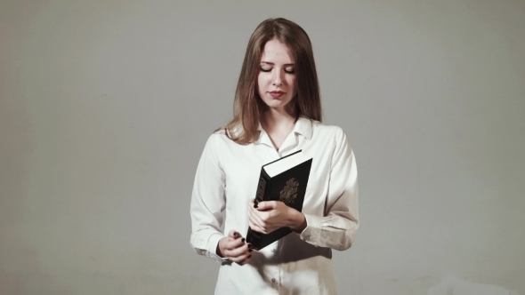 Young Christian Girl Reads The Bible