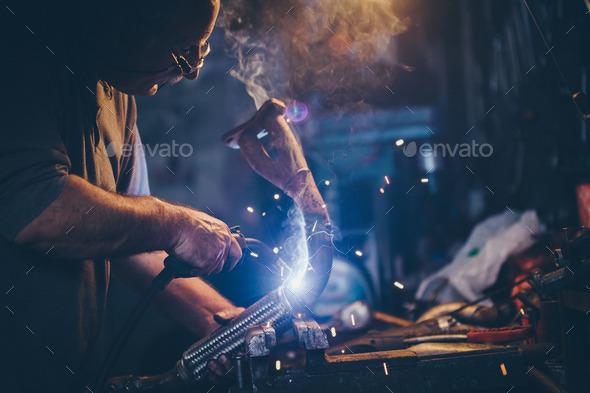 Craftsman weld steel.Retro filter, grain added. - Stock Photo - Images
