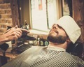 Hairstylist applying  beard powder in barber shop - PhotoDune Item for Sale