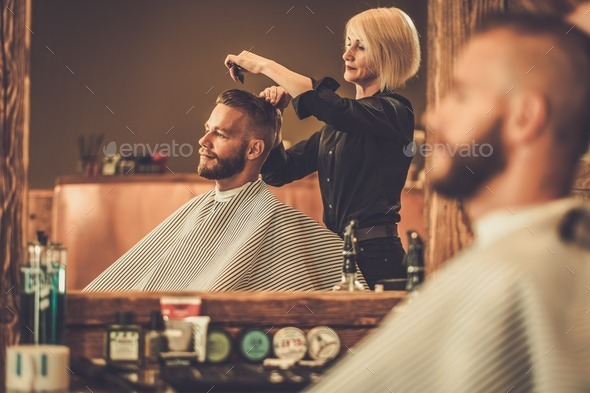 Client visiting hairstylist in barber shop - Stock Photo - Images