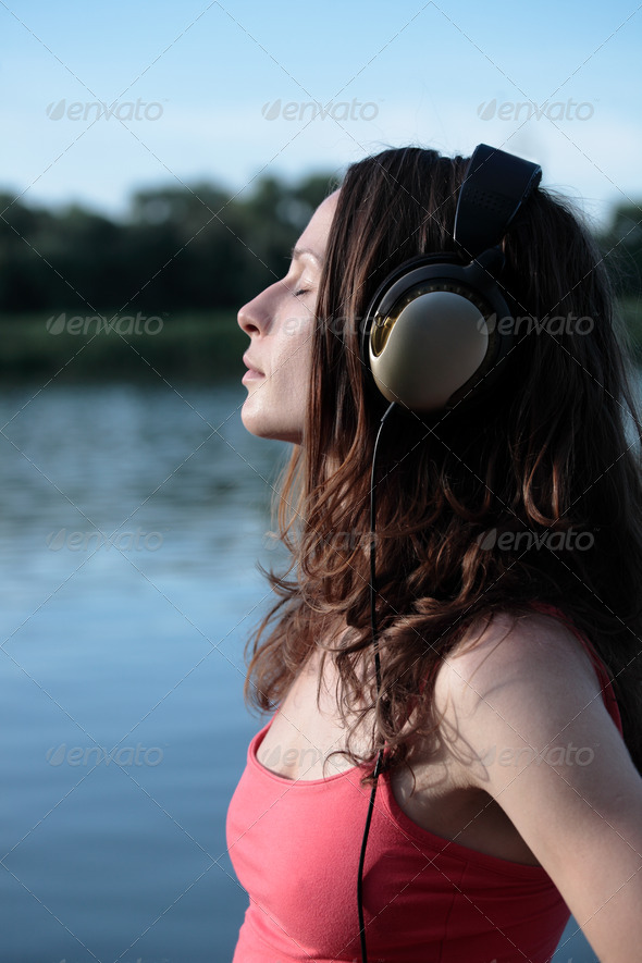 Cute woman listening to music - Stock Photo - Images