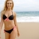 Blond Woman In Black Bikini Standing On Beach - VideoHive Item for Sale