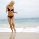 Woman In Bikini Playing In Beach Surf - VideoHive Item for Sale