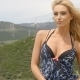 Blond Woman On Windy Hill Near Wind Farm - VideoHive Item for Sale