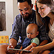 Young Parents with a Baby Watching in the Tablet - VideoHive Item for Sale