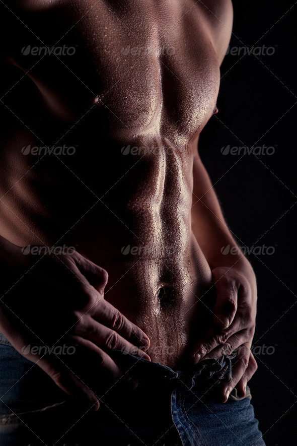Sexy muscular naked man with water drops on stomach - Stock Photo - Images